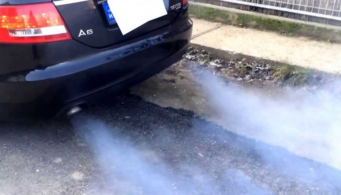 Blue smoke from car exhaust